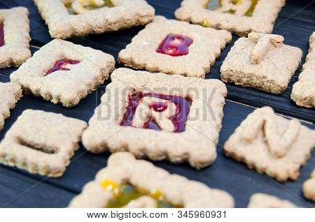 Isomalt Stained Glass Cookies With Letters. Christmas Or X-mas Baking Culinary Background, Cooking R
