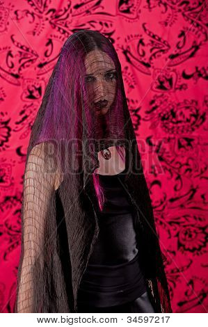 Mounring woman in black