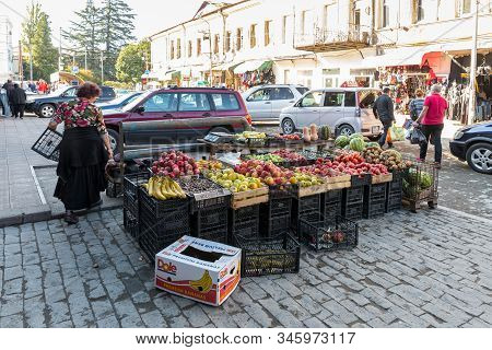 Kutaisi, Georgia, October 13, 2019 : A Counter With Vegetables And Fruits Stands On The Street Near