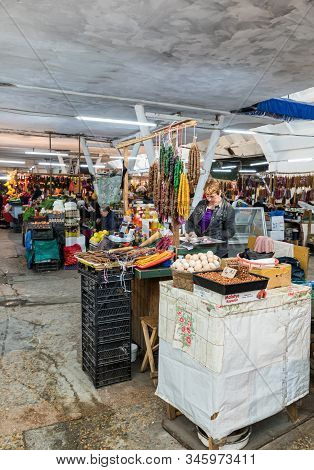 Kutaisi, Georgia, October 13, 2019 : Sellers Stand And Sit Near Their Food Stalls In The Market In T