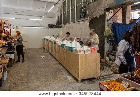 Kutaisi, Georgia, October 13, 2019 : Bulk Food Sellers Stand And Sit At Their Counters In The Market