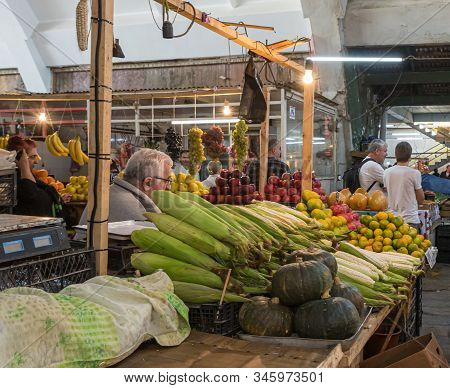 Kutaisi, Georgia, October 13, 2019 : Fresh Fruit And Vegetable Seller Sits At His Counter In The Mar