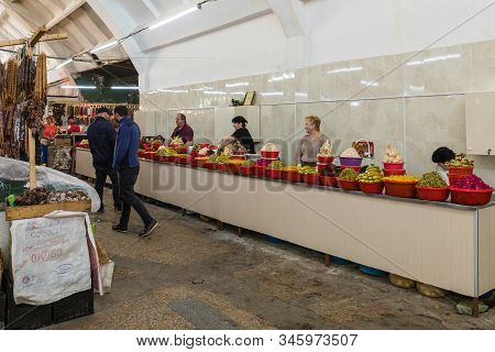 Kutaisi, Georgia, October 13, 2019 : Salty Foods Sellers Stand And Sit At Their Counters In The Mark