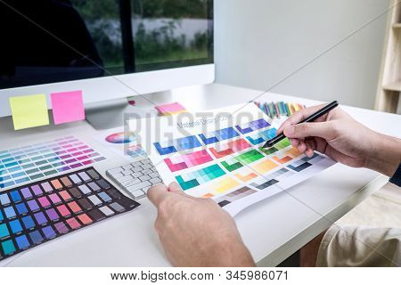 Male Creative Graphic Designer Working On Color Selection And Color Swatches, Drawing On Graphics Ta