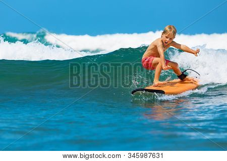 Happy Baby Boy - Young Surfer Learn To Ride On Surfboard With Fun On Sea Waves. Active Family Lifest