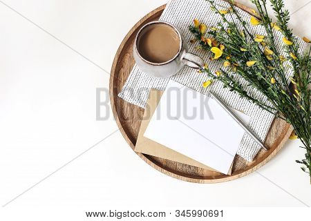 Spring Breakfast Scene. Yellow Broom Cytisus Branches, Linen Napkin, Cup Of Coffee, Wooden Tray Isol
