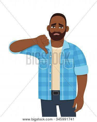 Unhappy Young African Man Showing Thumbs Down Gesture. Trendy Sad Black Person Making Dislike Sign.