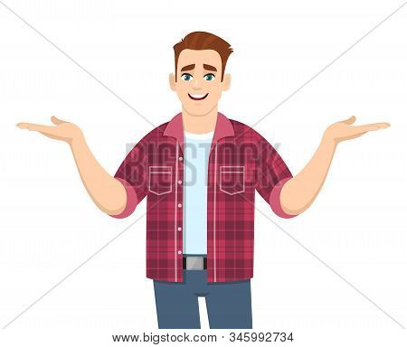 Stylish Young Man Showing Or Spreading Hands To Copy Space Side. Smiling Person In Trendy Casual Dre