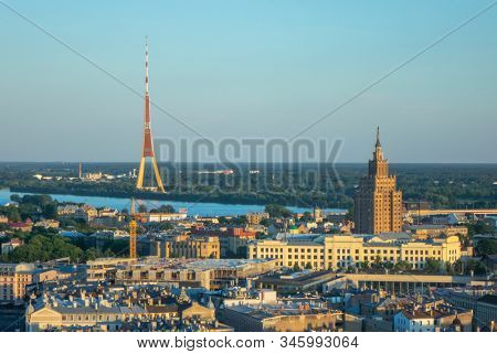 Aerial view from drone to Riga Radio and TV Tower Academy of Sciences and river Daugava in a summer sunny day. Riga, Latvia.