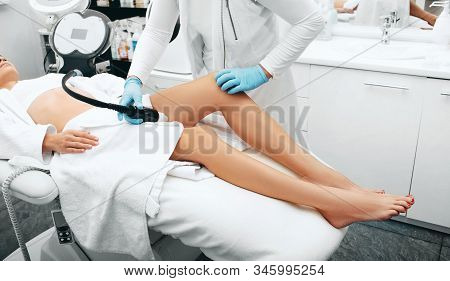 Acoustic Wave Therapy Remove Skin Stretch Marks On Female Legs. Remove Cellulite On The Legs Of A Be