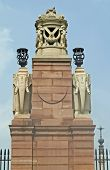 Ornate stone pillar at the entrance to Rashtrapati Bhavan (former Viceroy's House when Indian was under British rule). Large imperial building. poster