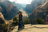 girl traveller on Zion National Park in southwestern Utah near the town of Springdale, USA poster