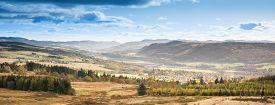 Fall Landscape In Perthshire In Scotland. Orange Color. River Scene. Autumnal Scene With Colorful Tr