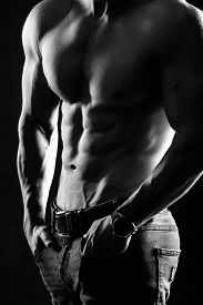 Bodybuilder Posing. Handsome Power Athletic Guy Male. Fitness Muscular Body On Black Background. Bla