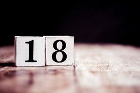 Number 18 Isolated On Dark Background- 3d Number Eightteen Isolated On Vintage Wooden Table