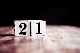 Number 21 Isolated On Dark Background- 3d Number Twenty One Isolated On Vintage Wooden Table