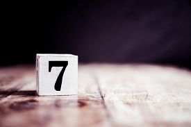 Number 7 Isolated On Dark Background- 3d Number Seven Isolated On Vintage Wooden Table