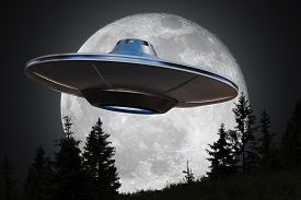 Alien Spaceship (ufo) Is Flying At Night. Moon In Background.