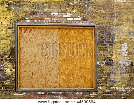 Old Brick Wall With Boarded Up Window