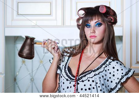 Housewife with an old coffeepot