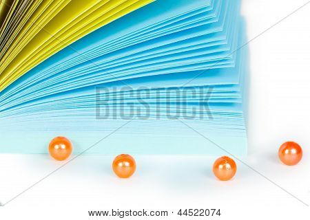 Paper records with orange beads