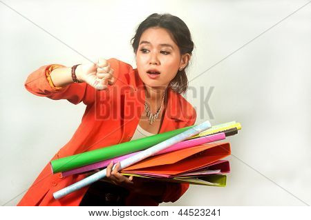 Pretty  young Business Woman Holding Folders And Papers Is  Hastily . poster