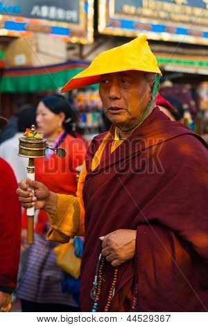 Tibetan Buddhist Monk Spinning Prayer Wheel