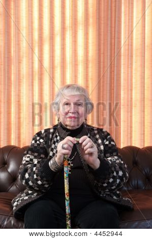 86 Year Old Woman At Her Home, Holding Cane