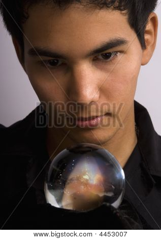 Man Staring Into A Crystal Ball