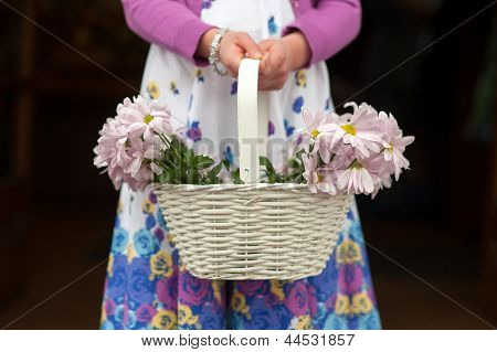 Flowergirl With Basket Of Flowers At A Wedding