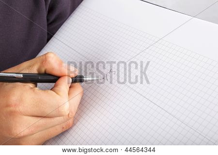 man  writing with a pen in a  book poster