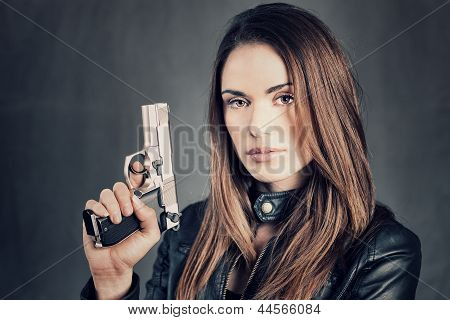 Woman Holding Up Her Gun