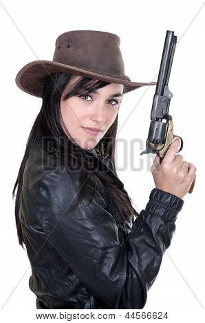 Beautiful Brunette Cowgirl Model Holding A Gun