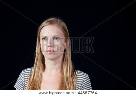 Pretty blond woman with serious expression