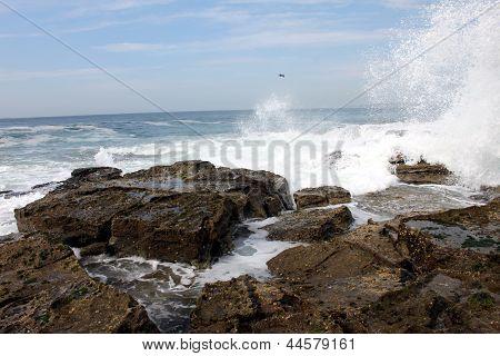 Waves Crashing On A Rocky Beach In Australia