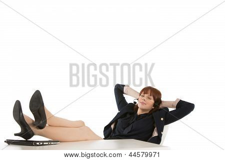 Businesswoman With Her Feet On The Desk