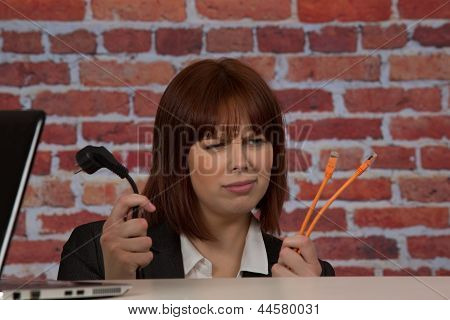 Confused Woman Plugging In Her Laptop