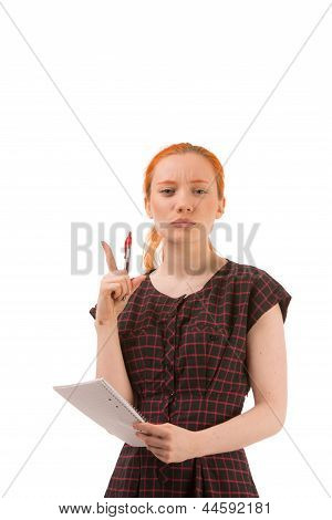 Thoughtful Woman Holding A Notebook