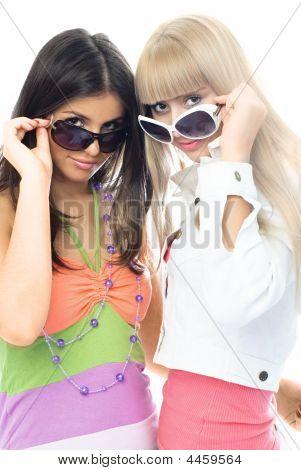 Two Beautiful Girls Trying On Sun Glasses