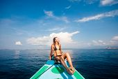 Young sexy woman in bikini enjoying the sun on the boat poster