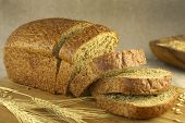 Bread cut on a blurry background (horizontal) poster
