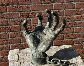 Stone chained hand