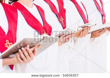 close up portrait of church choir holding hymn books
