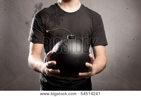 young man holding an old fashioned bomb