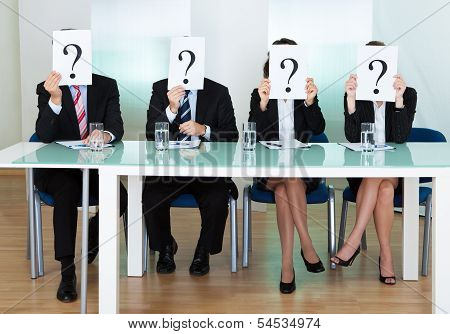 Row Of Businesspeople With Question Marks
