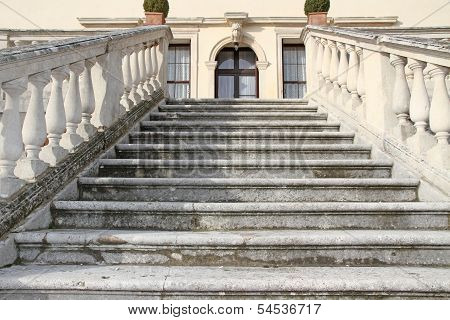Grand Staircase That Rises Upwards Of A Villa