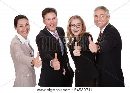 Business Executives Giving A Thumbs Up