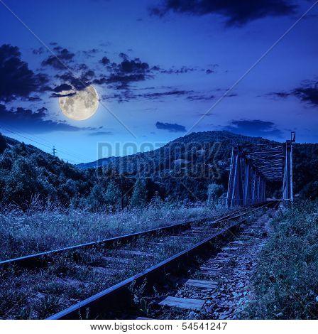 Night Rail Metal Bridge In Mountains