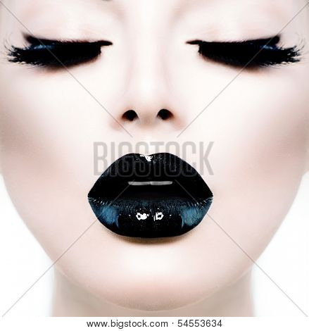 High Fashion Beauty Model Girl with Black Make up and Long Lushes. Black Lips. Dark Lipstick and White Skin. Vogue Style Portrait