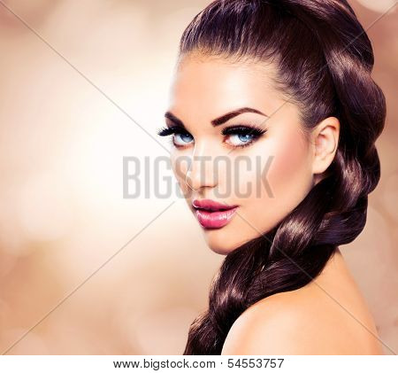 Hair Braid. Beautiful Woman with Healthy Long Brown Hair. Hairdressing. Hairstyle. Beauty Glamour Fashion Model Girl Portrait. Perfect Skin and Makeup Holiday Make up. Blue eyes and Red Lipstick
